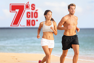 Couple running. Sport runners jogging on beach working out smili